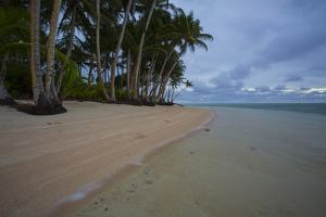 A Pristine Beach on the Uninhabited Island of Tatak in Papua New Guinea by Luis Lamar