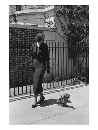 Vogue - August 1934 - Woman Walking her Pet Dachshund by Lusha Nelson