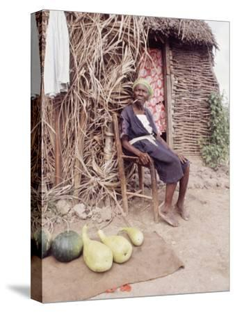Old Haitian Woman in Front of Her Hut