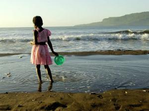 A Girl Walks on the Beach in Jacmel, Haiti, in This February 5, 2001 by Lynne Sladky