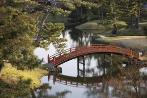 A Footbridge over Water in a Garden by Macduff Everton