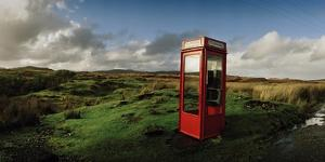 A Telephone Booth Standing Alone on a Remote Moor by Macduff Everton