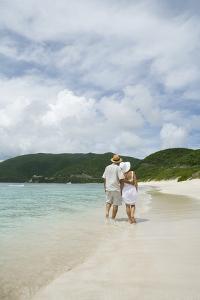 Couple Walking on Savannah Bay Beach by Macduff Everton