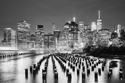 Black and White Picture of the New York City at Night by Maciej Bledowski
