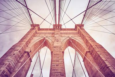 Looking up at the Brooklyn Bridge, New York by Maciej Bledowski