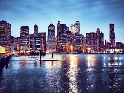 Manhattan Skyline Reflected in East River at Dusk