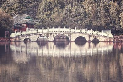 Retro Toned Picture of Suocui Bridge, Lijiang, China. by Maciej Bledowski