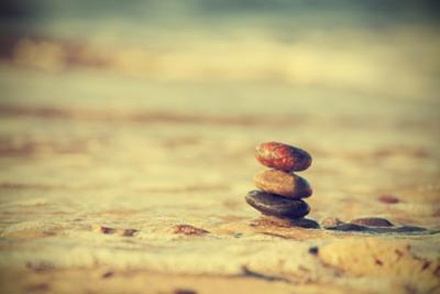 Vintage Retro Hipster Style Image of Stones on Beach, Zen Spa Concept Background. by Maciej Bledowski