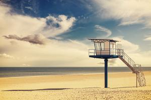 Vintage Retro Style Filtered Picture of a Lifeguard Tower on a Beach. by Maciej Bledowski