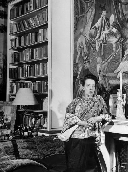 Madam Elsa Schiaparelli Enjoying Her Study Which is Filled with Treasures, Paintings, and Books-Hans Wild-Premium Photographic Print
