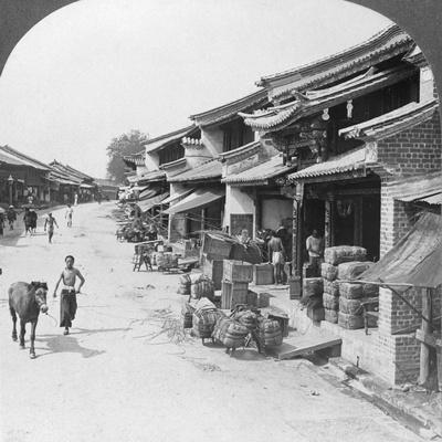 https://imgc.artprintimages.com/img/print/main-business-street-of-the-chinese-quarter-bhamo-burma-1908_u-l-q10lxsq0.jpg?p=0