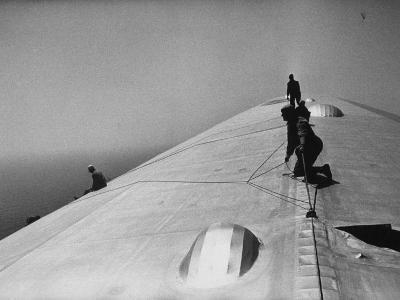 Maintenance Crewmen on Top of Graf Zeppelin repair damage caused Atlantic Ocean Storm during flight-Alfred Eisenstaedt-Photographic Print
