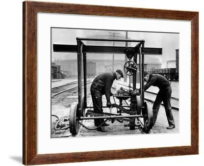 Making Repairs--Framed Photographic Print