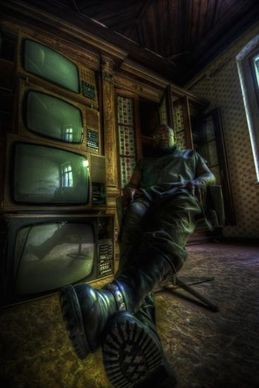 Male Figure in Abandoned Building with Televisions-Nathan Wright-Photographic Print