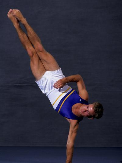 Male Gymnast Performing on the Floor Exercise--Photographic Print