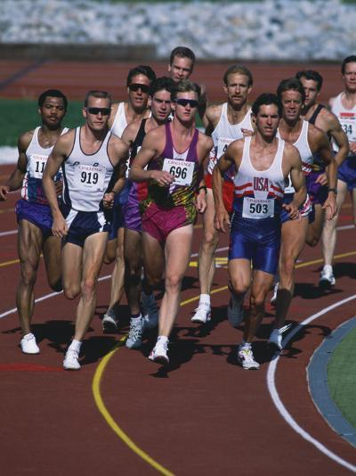 Male Runners Competing in a Track Race--Photographic Print