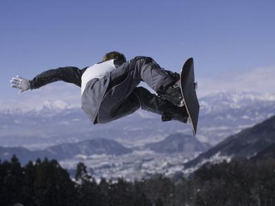 Male Snowboarder Flying over the Vert--Photographic Print