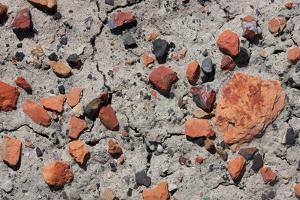 Close-Up Shot of the Earth of the Bisti with Rocks of Iron Ore by Mallorie Ostrowitz