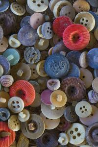 Pile of antique buttons by Mallorie Ostrowitz