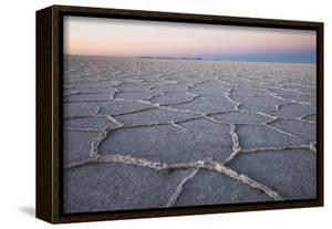 The largest salt flats in the world located in Uyuni, bolivia as the sun is rising in winter. by Mallorie Ostrowitz