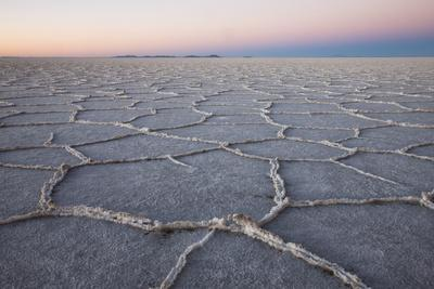 The largest salt flats in the world located in Uyuni, bolivia as the sun is rising in winter.