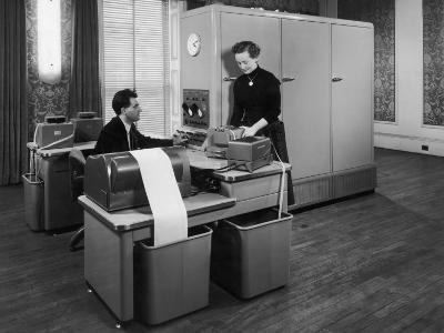 Man and a Women Working Together with a Pegasus Computer--Photographic Print