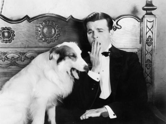 Man and Dog Sitting Together Yawning--Photo