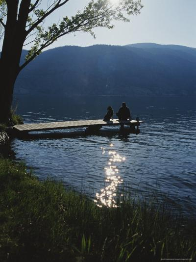 Man and His Dog on a Lake Skaha Dock-Mark Cosslett-Photographic Print