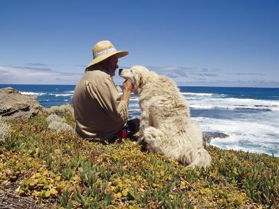 Man and His Italian Sheep Dog Sit Overlooking the Ocean-Jason Edwards-Photographic Print
