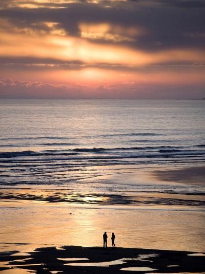 Man and Woman in Silhouette Looking Out Over North Sea at Sunsrise From Alnmouth Beach, England-Lee Frost-Photographic Print