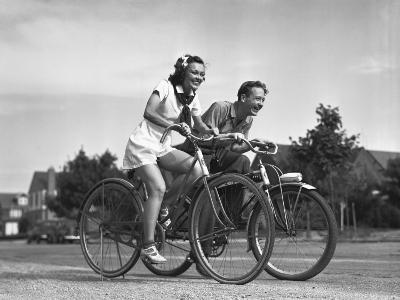 Man and Woman Riding Bicycles, (B&W),-George Marks-Photographic Print