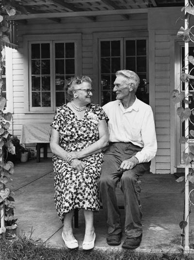 Man and Woman Sitting on Porch--Photographic Print