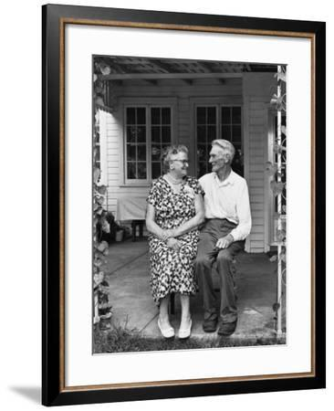 Man and Woman Sitting on Porch--Framed Photographic Print