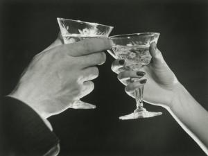 Man and Woman Toasting Martini Glasses, Close Up of Hands