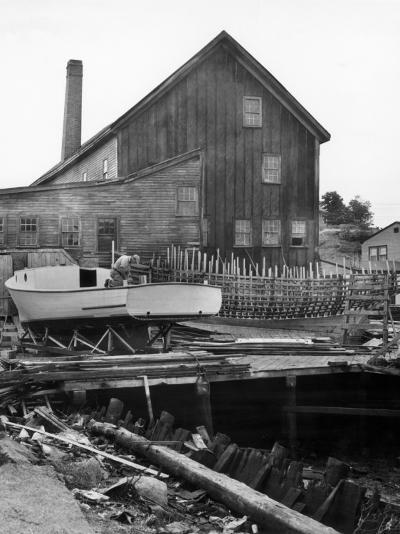 Man Building Boat-George Marks-Photographic Print