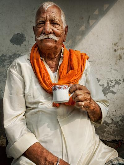 Man Drinking His Afternoon Chai-April Maciborka-Photographic Print