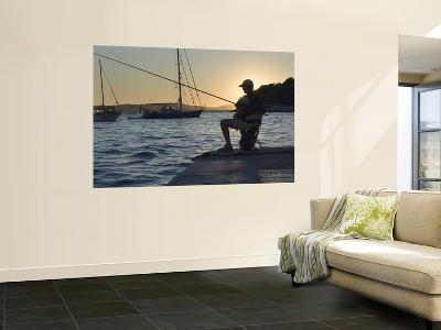 Man Fishing at Sunset at Port-Will Salter-Wall Mural