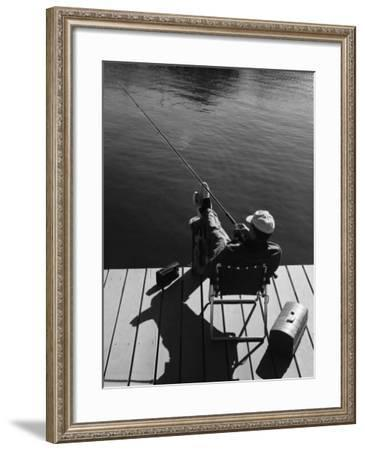 Man Fishing From Dock--Framed Photographic Print
