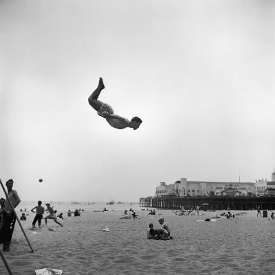 Man Flying Off a Trampoline at Santa Monica Beach-Loomis Dean-Photographic Print