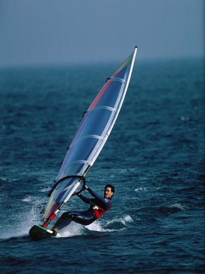 Man Glides the Waves While Windsurfing-Jeff Foott-Photographic Print