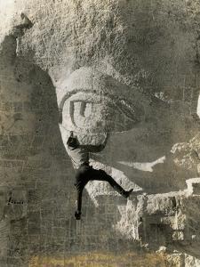 Man Hangs Onto Eye at Mount Rushmore