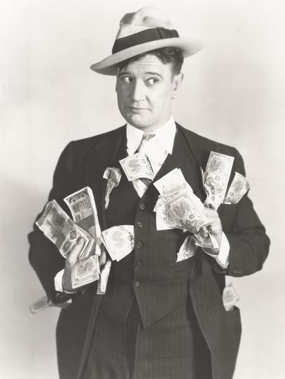 Man Holding Wads of Fake Money--Photo