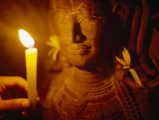 Man Holds a Candle Up to a Stone Carving at the Angkor Wat Temple-xPacifica-Photographic Print