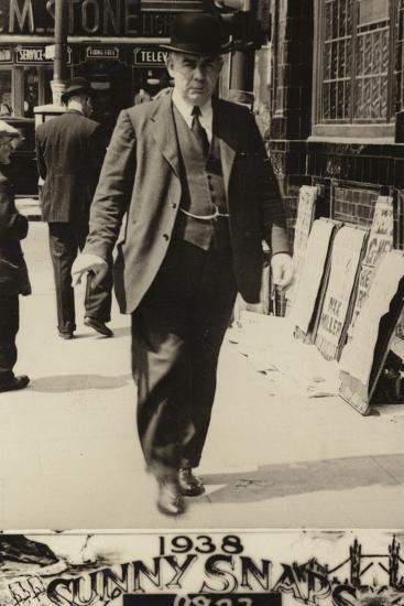 Man in a Bowler Hat Walking Along a Street, 1938--Photographic Print