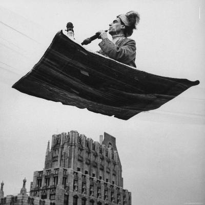 Man in Arabic Dress, Smoking a Water Cooled Pipe, is Comfortably Sitting on a Magic Carpet-Andreas Feininger-Photographic Print