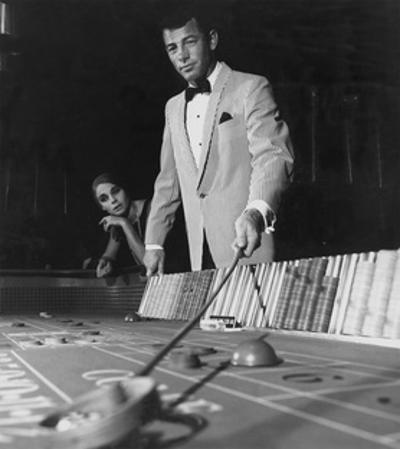 Man in One-Button Pinstripe Jacket Works a Table at a Casino