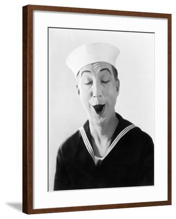 Man in Sailor Hat and Uniform Making a Silly Pantomime Face--Framed Photo