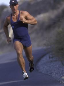 Man Jogging Down a Hill