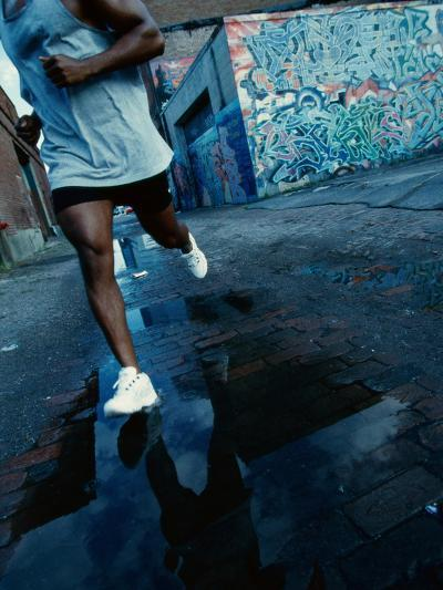 Man Jogging in the City--Photographic Print