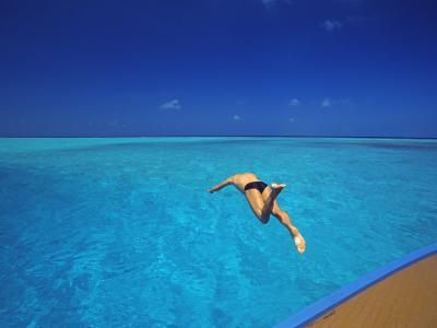 Man Jumping into Tropical Sea from Deck, Maldives, Indian Ocean-Papadopoulos Sakis-Photographic Print